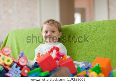 Portrait of  three-year child in home interior - stock photo