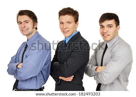 Portrait of three young business people on isolate white background