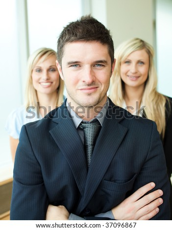 Portrait of three young business people with folded arms - stock photo