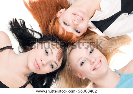 Portrait of three young cheerful women on white background - stock photo