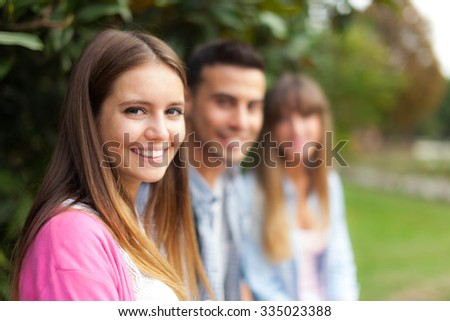 Portrait of three young persons in a row - stock photo