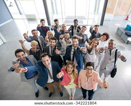 Portrait of thumb up smiling business people  - stock photo