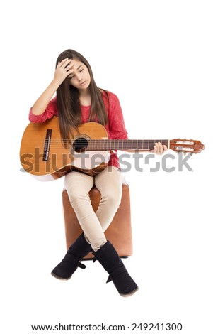 Portrait of tired  teenage girl and her guitar isolated over white background