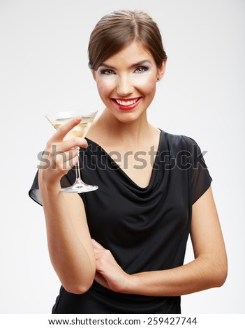 Portrait of toothy smiling woman holding glass with drink.Black evening dress. Girl celebrating event isolated portrait. - stock photo