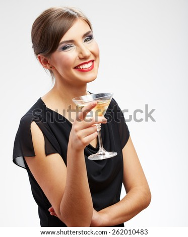 Portrait of toothy smiling woman holding glass with drink.Black evening dress. Girl celebrating event isolated portrait.