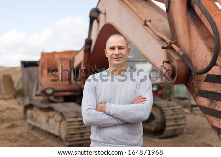 Portrait of tractor operator at workplace - stock photo