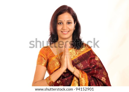 Portrait of traditional Indian woman holding hands in prayer position