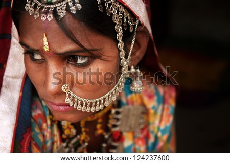 Portrait of Traditional Indian woman in sari costume covered her face with veil, India - stock photo