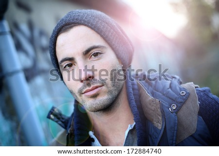 Portrait of trendy guy in abandoned place - stock photo