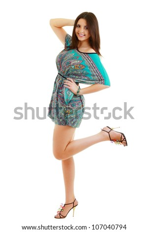 Portrait of trendy young woman in funky dress smiling against white background - stock photo