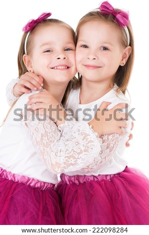 Portrait of twin girls - stock photo