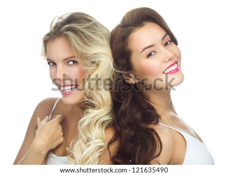 portrait of two attractive  caucasian smiling women blond isolated on white studio shot  toothy smile face long hair head and shoulders looking at camera - stock photo