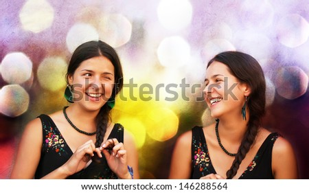 Portrait of two attractive teen girls having fun - stock photo