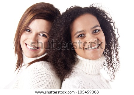 Portrait Of Two Attractive Young Women In Studio - stock photo