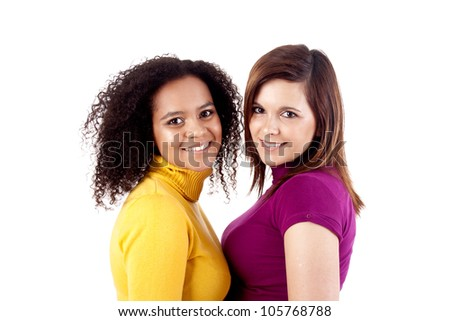 Portrait Of Two Attractive Young Women In Studio