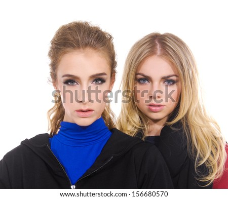 Portrait Of two Attractive Young Women In Studio Standing - stock photo