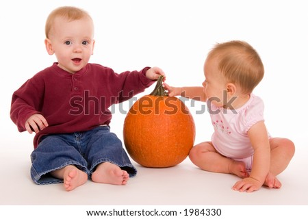 Portrait of two babies with a halloween theme. - stock photo