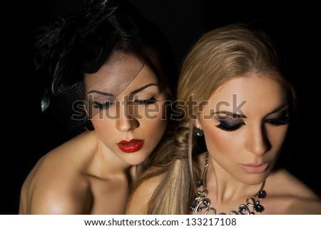 portrait of two beautiful girls - stock photo