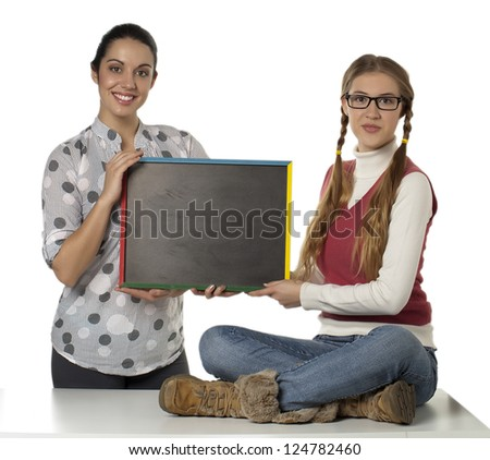 Portrait of two beautiful girls holding blackboard against white background - stock photo