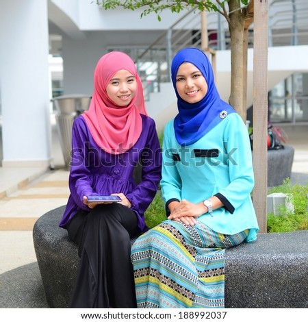 Portrait of two beautiful muslim woman take rest together