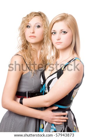 Portrait of two beautiful young women. Isolated