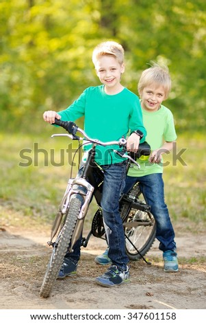 Portrait of two boys in the summer outdoors - stock photo