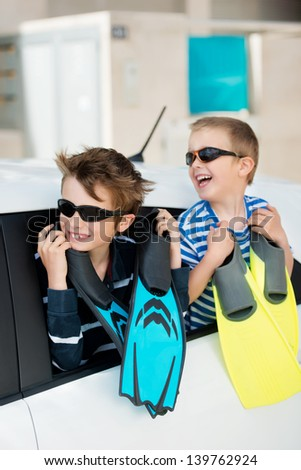 Portrait of two brothers excited for the holidays - stock photo