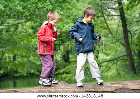 Portrait of two brothers outdoors in a park. - stock photo