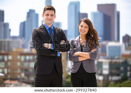 Portrait of two business people young attractive entrepreneurs team leaders CEO - stock photo