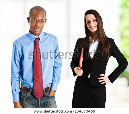 Portrait of two business persons - stock photo