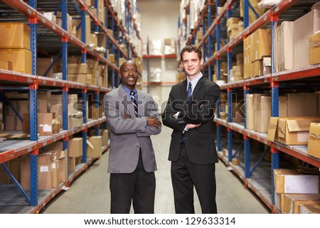 Portrait Of Two Businessmen In Warehouse - stock photo