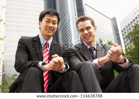 Portrait Of Two Businessmen Outside Office - stock photo