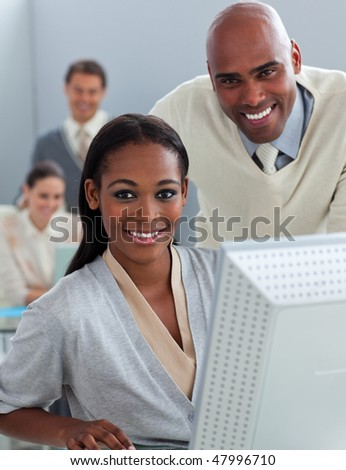 Portrait of two businesspeople working at a computer in the office
