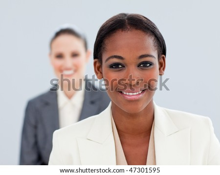 Portrait of two charming businesswomen standing - stock photo