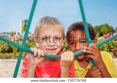 Portrait of two cheerful boys at the playground - stock photo