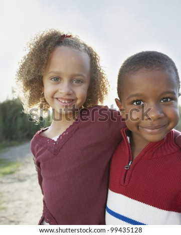 Portrait of two children hugging