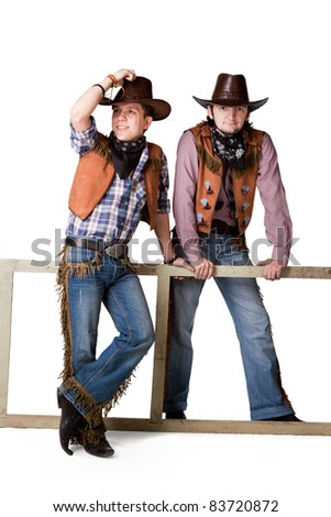 Portrait of two cowboys to the utmost isolated on a white background - stock photo