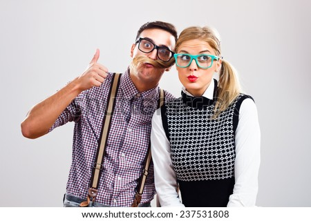 Portrait of two cute nerds having fun,Nerds having fun - stock photo