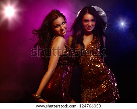 Portrait of two dancing girls on disco party - stock photo