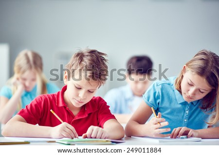 Portrait of two diligent classmates at lesson - stock photo