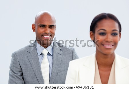 Portrait of two ethnic business people in a company - stock photo
