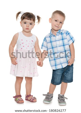 Portrait of two fashion small children on the white background