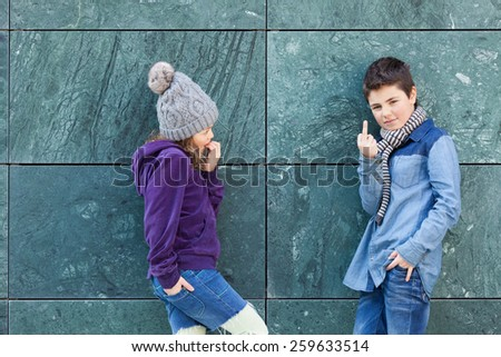 portrait of two fashionable kids, outdoors - stock photo