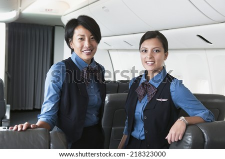 Portrait of two female flight attendants - stock photo