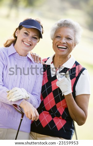 Portrait Of Two Female Golfers - stock photo