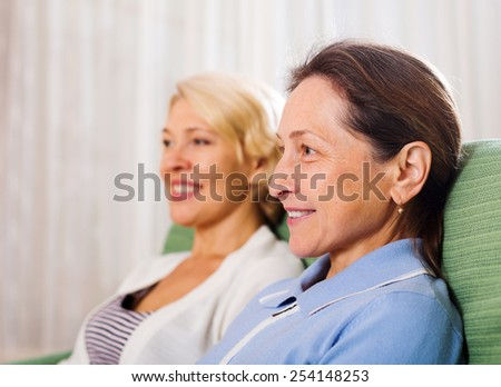 Portrait of two  female pensioners at home