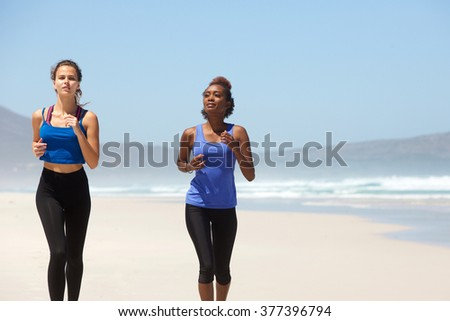 Portrait of two female runners exercising on the beach