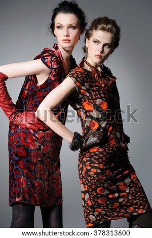 Portrait of two female sundress clothing on display   - stock photo