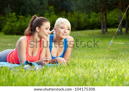 Portrait of two fitness woman having fun in summer environment - stock photo