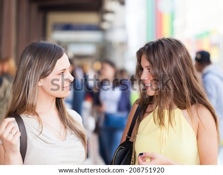 Portrait of two friends talking together